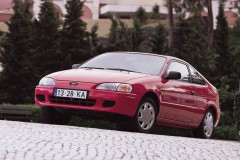 Red Toyota Paseo coupe front