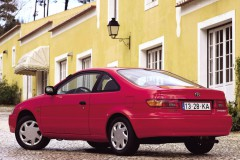 Red Toyota Paseo coupe side